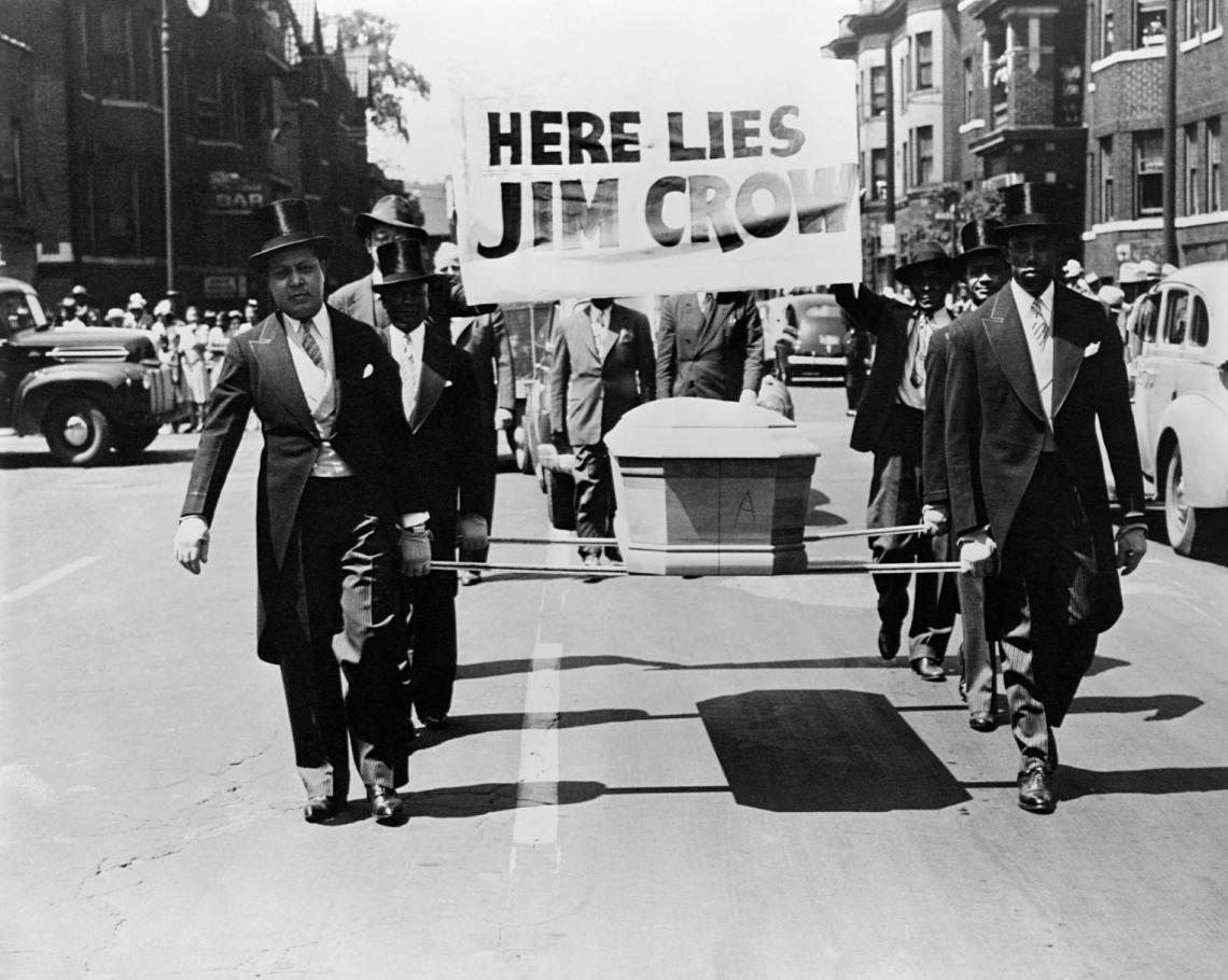 Men carry the coffin of Jim Crow through the streets to protest racial discrimination in 1944.  PHOTOGRAPH BY CORBIS.jpg